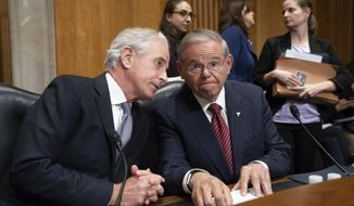 Senate Foreign Relations Committee Chairman Bob Corker, R-Tenn., and Sen. Bob Menendez, D-N.J., the ranking member, right, oversee the confirmation vote on President Donald Trump's nominee for secretary of state, Mike Pompeo, who has faced considerable opposition before the panel, on Capitol Hill in Washington, Monday, April 23, 2018. (AP Photo/J. Scott Applewhite)