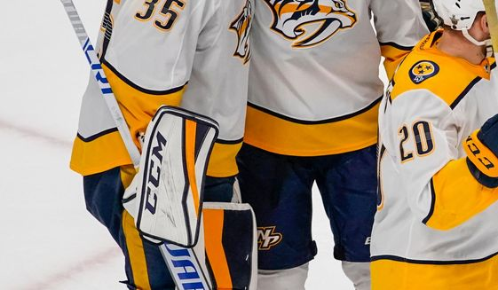 Nashville Predators goaltender Pekka Rinne (35) and Mike Fisher (12) celebrate a 5-0 series-winning victory against the Colorado Avalanche during Game 6 of an NHL hockey first-round playoff series, Sunday, April 22, 2018, in Denver. (AP Photo/Jack Dempsey)