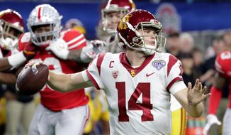 FILE - In this Dec. 29, 2017, file photo, Southern California quarterback Sam Darnold (14) throws a pass with teammates providing blocking against Ohio State during the first half of the Cotton Bowl NCAA college football game in Arlington, Texas. Every quarterback prospect in the upcoming NFL draft has a major flaw or drawback that keeps them from being the consensus best one of the bunch. (AP Photo/LM Otero, File) **FILE**