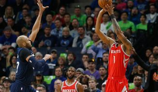 Houston Rockets' Trevor Ariza, right, shoots over Minnesota Timberwolves' Taj Gibson during the first half of Game 4 in an NBA basketball first-round playoff series Monday, April 23, 2018, in Minneapolis. (AP Photo/Jim Mone)