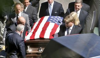 Pallbearers carry the casket of former professional wrestler Bruno Sammartino Monday, April 23, 2018, in Ross Township, Pa., a suburb just north of Pittsburgh. (AP Photo/Keith Srakocic)