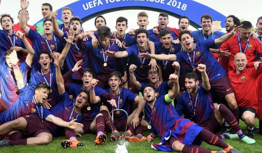 Barcelona's players celebrate the victory in the UEFA Youth League final soccer match between Britain's Chelsea FC U-19 and Spain's FC Barcelona Juvenil A, at the stadium Colovray Sports Centre, in Nyon, Switzerland, Monday, April 23, 2018. (Laurent Gillieron/Keystone via AP)