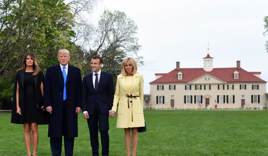 President Donald Trump, first lady Melania Trump, French President Emmanuel Macron and his wife Brigitte Macron pose for a photo in front of Mount Vernon, the home of President George Washington, in Mount Vernon, Va., Monday, April 23, 2018. (AP Photo/Susan Walsh) ** FILE **