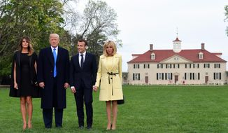 President Donald Trump, first lady Melania Trump, French President Emmanuel Macron and his wife Brigitte Macron pose for a photo in front of Mount Vernon, the home of President George Washington, in Mount Vernon, Va., Monday, April 23, 2018. (AP Photo/Susan Walsh)