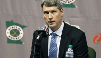 FILE - In this May 10, 2016, file photo, Minnesota Wild general manager Chuck Fletcher speaks at a news conference in St. Paul, Minn. Fletcher was fired Monday, April 23, 2018, after the hockey team's first-round playoff exit. Fletcher was the Wild's general manager for nine seasons. (AP Photo/Jim Mone, File)