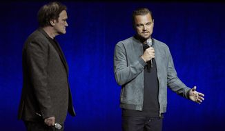 "Leonardo DiCaprio, right, a cast member in the upcoming film ""Once Upon a Time in Hollywood,"" addresses the audience as the film's writer/director Quentin Tarantino looks on during the Sony Pictures Entertainment presentation at CinemaCon 2018, the official convention of the National Association of Theatre Owners, at Caesars Palace on Monday, April 23, 2018, in Las Vegas. (Photo by Chris Pizzello/Invision/AP)"