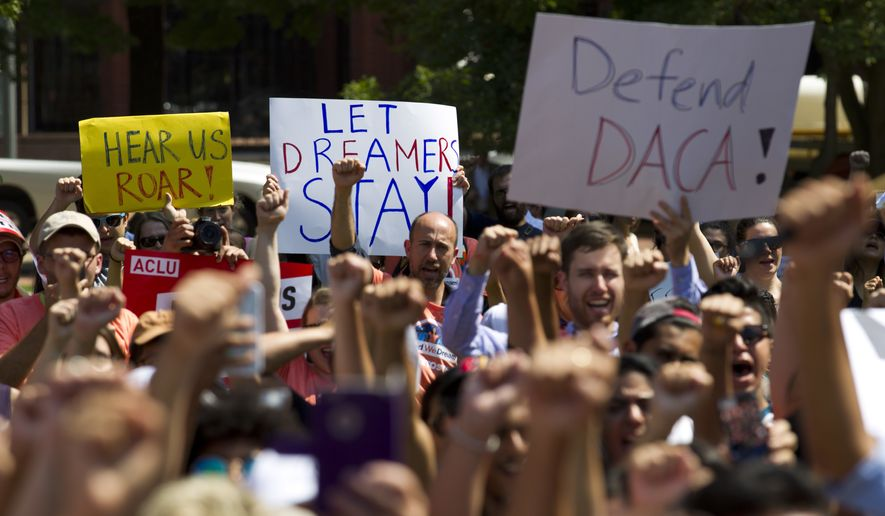 Protesters hold up signs during a rally supporting Deferred Action for Childhood Arrivals, or DACA, outside of the White House in Washington, on Tuesday, Sept. 5, 2017. (AP Photo/Jose Luis Magana) ** FILE **