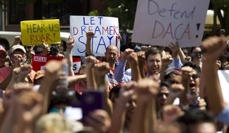 "Protesters hold up signs during a rally supporting Deferred Action for Childhood Arrivals, or DACA, outside of the White House in Washington, on Tuesday, Sept. 5, 2017. President Donald Trump's administration will ""wind down"" a program protecting hundreds of thousands of young immigrants who were brought into the country illegally as children, Attorney General Jeff Sessions declared Tuesday, calling the Obama administration's program ""an unconstitutional exercise of authority."" ( AP Photo/Jose Luis Magana)"