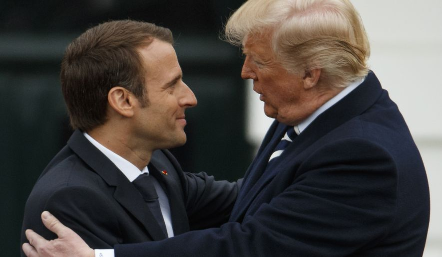President Donald Trump hugs French President Emmanuel Macron during a State Arrival Ceremony on the South Lawn of the White House, Tuesday, April 24, 2018, in Washington. (AP Photo/Evan Vucci)