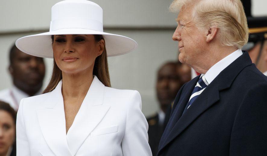 5755bdba9 Melania Trump, in Herve Pierre hat and Michael Kors skirt suit ...