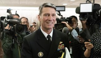 Rear Adm. Ronny Jackson, President Donald Trump's choice to be secretary of the Department of Veterans Affairs, leaves a Senate office building after meeting individually with some members of the committee that would vet him for the post, on Capitol Hill in Washington, Tuesday, April 24, 2018.  (AP Photo/J. Scott Applewhite) ** FILE **