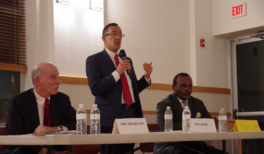 On April 23, 2018, file photo, the D.C. Board of Elections kicked perennial candidate Calvin Gurley (far right) off the primary ballot for the race for D.C. Council Chairman after finding invalid signatures on his nomination petition. This leaves the primary race between incumbent candidate Phil Mendelson (left) and newcomer challenger Ed Lazere (center). (Julia Airey/The Washington Times) ** FILE **