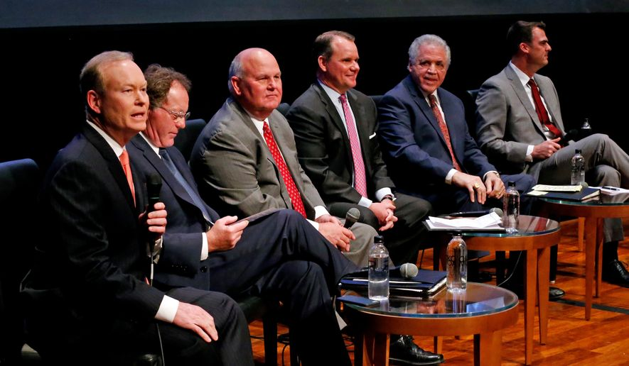 In this Monday, April 23, 2018, photo, Republican gubernatorial candidates, from left, Mick Cornett, Dan Fisher, Gary Jones, Todd Lamb, Gary Richardson and Kevin Stitt participate in a forum for candidates at the Oklahoma City Museum of Art on in Oklahoma City, Okla. (Steve Sisney/The Oklahoman via AP)