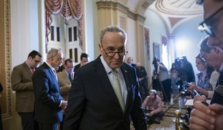 Senate Minority Leader Chuck Schumer, D-N.Y., turns to confer with an aide during a news conference where he talked about the confirmation battle over President Donald Trump's nominee for secretary of state, Mike Pompeo, on Capitol Hill in Washington, Tuesday, April 24, 2018. (AP Photo/J. Scott Applewhite)
