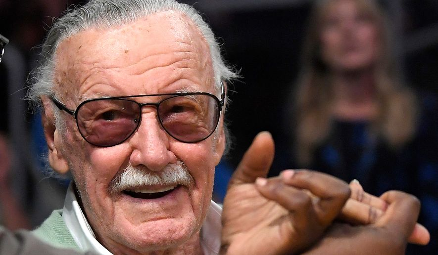 In this Oct. 27, 2017, photo, famed comic book creator Stan Lee appears at an NBA basketball game between the Los Angeles Lakers and the Toronto Raptors in Los Angeles. (Associated Press) **FILE**