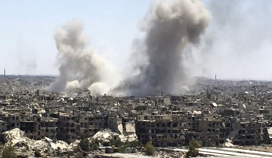 Smoke rises after Syrian government airstrikes and shelling hit in Hajar al-Aswad neighborhood held by Islamic State militants, southern Damascus, Syria, Tuesday, April 24, 2018. Syrian state TV is reporting that government forces have launched a new operation targeting underground tunnels used by the Islamic State group in the capital, Damascus. (AP Photo) **FILE**