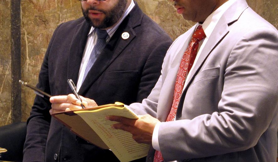 FILE -In this March 9, 2016 file photo, state Sen. J.P. Morrell, left, a Democrat who chairs the Senate tax committee, talks with a Senate staff member on the final day of the special legislative session on the budget and taxes in Baton Rouge, La. Morrell's effort to strengthen anti-bestiality laws is facing unlikely opposition from lawmakers who see it as an underhanded move to strike the state's unconstitutional ban on sodomy. Opponents say current law in Louisiana is fine. (AP Photo/Melinda Deslatte, File)