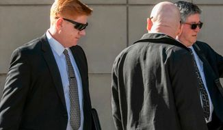 FILE - In this March 21, 2018, file photo, Border Patrol agent Lonnie Swartz, left, makes his way to the U.S. District Court building in downtown Tucson, Ariz., where opening arguments were scheduled to begin in his murder trial. A mistrial was declared Monday, April 23, in the case of Swartz after an Arizona jury acquitted him of a second-degree murder charge in the killing of a teen from Mexico but deadlocked on lesser counts of manslaughter. (Ron Medvescek/Arizona Daily Star via AP, File)