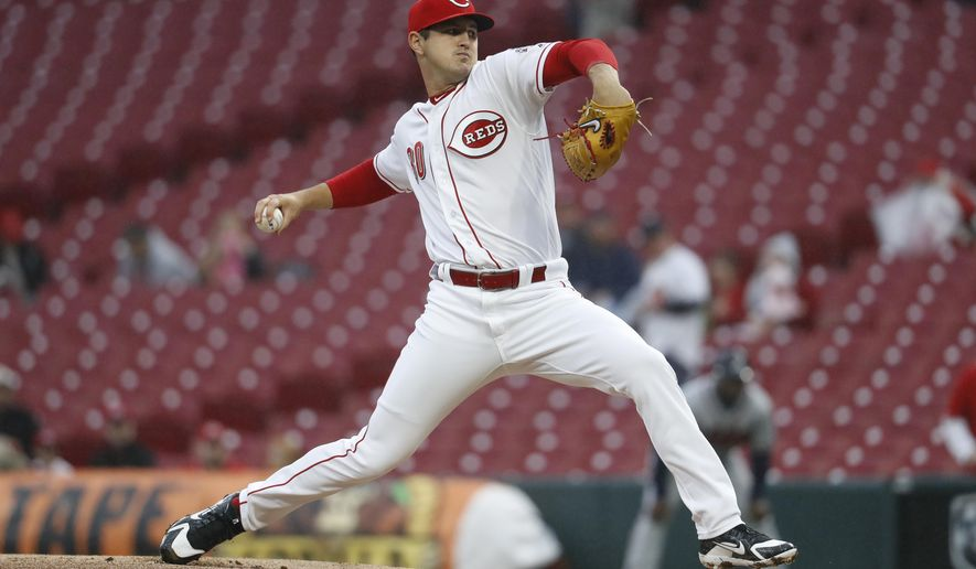 Cincinnati Reds starting pitcher Tyler Mahle throws during the first inning of the team's baseball game against the Atlanta Braves, Tuesday, April 24, 2018, in Cincinnati. (AP Photo/John Minchillo)