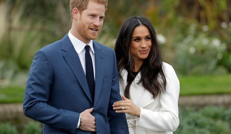 FILE - In this Monday Nov. 27, 2017 file photo, Britain's Prince Harry and his fiancee Meghan Markle pose for photographers in the grounds of Kensington Palace in London. A dramatic ball gown, or a classic, simple silhouette? Sleeves, or bare shoulders? With less than a month to go until she marries Prince Harry at Windsor Castle on May 19, Meghan Markle most likely has already chosen her wedding dress - though what it looks like is expected to remain a top secret until the last minute. (AP Photo/Matt Dunham, file)