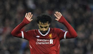 Liverpool's Mohamed Salah celebrates after scoring his side's second goal during the Champions League semifinal, first leg, soccer match between Liverpool and Roma at Anfield Stadium, Liverpool, England, Tuesday, April 24, 2018. (AP Photo/Rui Vieira)