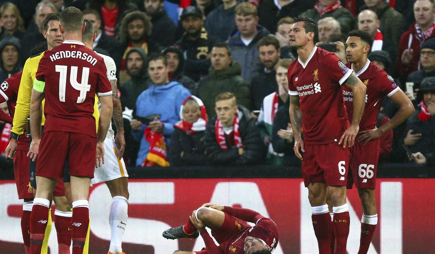 Liverpool's Alex Oxlade-Chamberlain grimaces on the ground after getting injured during the Champions League semifinal, first leg, soccer match between Liverpool and AS Roma at Anfield Stadium, Liverpool, England, Tuesday, April 24, 2018. (AP Photo/Dave Thompson)