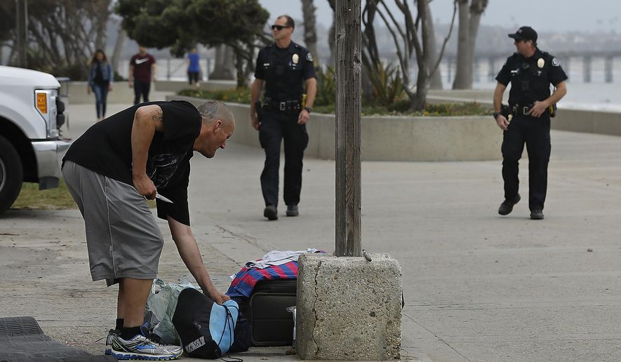 In this Monday, April 23, 2018 photo, Ventura police officers Schuyler Heard, left, and Tim Davis patrol along the Promenade in Ventura, Calif., near Aloha Steakhouse where Anthony Mele Jr., 35, was stabbed to death by a homeless man as he was having dinner with his wife and five-year-old daughter. (Mel Melcon/Los Angeles Times via AP