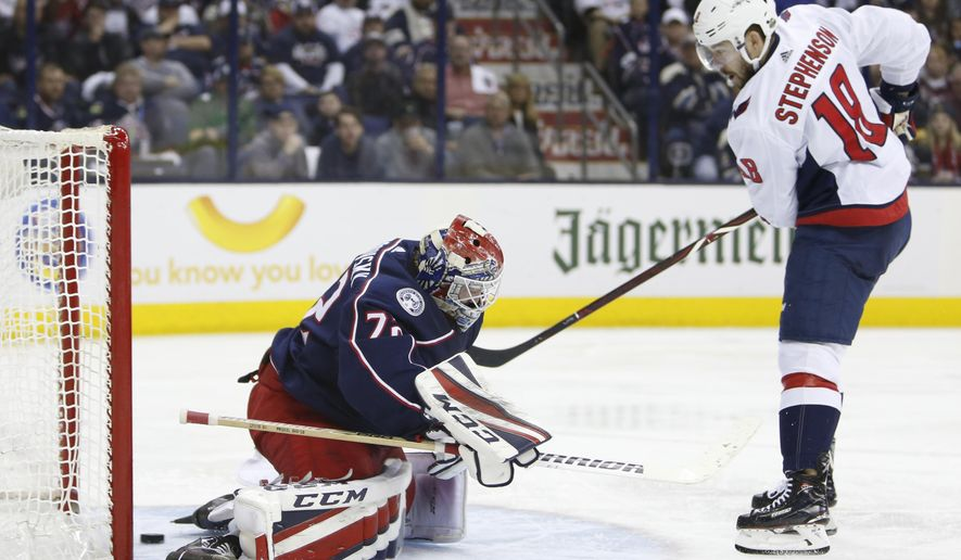 Washington Capitals' Chandler Stephenson, right, scores against Columbus Blue Jackets' Sergei Bobrovsky, of Russia, during the third period of Game 6 of an NHL first-round hockey playoff series Monday, April 23, 2018, in Columbus, Ohio. The Capitals defeated the Blue Jackets 6-3. (AP Photo/Jay LaPrete) ** FILE **
