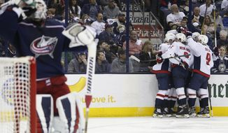 Washington Capitals players celebrate their goal against the Columbus Blue Jackets during the third period of Game 6 of an NHL first-round hockey playoff series Monday, April 23, 2018, in Columbus, Ohio. The Capitals defeated the Blue Jackets 6-3. (AP Photo/Jay LaPrete)