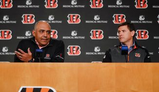 FILE - In this Jan. 3, 2018, file photo, Cincinnati Bengals head coach Marvin Lewis, left, speaks alongside offensive coordinator Bill Lazor, right, during a news conference in Cincinnati. Offensive coordinator Bill Lazor has been given a free hand to overhaul the offense, and the Bengals are expected to put a heavy accent on it during the draft. (AP Photo/John Minchillo, File)