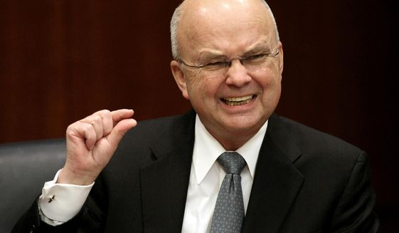 In this Jan. 15, 2009, file photo, then-CIA Director Michael Hayden gestures during a news conference at CIA headquarters in Langley, Va. (AP Photo/Luis M. Alvarez, File)