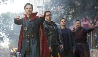 "This image released by Marvel Studios shows, from left, Benedict Cumberbatch, Robert Downey Jr., Mark Ruffalo and Benedict Wong in a scene from ""Avengers: Infinity War."" (Marvel Studios via AP)"