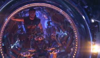"This image released by Marvel Studios shows Chris Hemsworth as Thor. with characters Rocket, voiced by Bradley Cooper, seated center, and Groot, voiced by Vin Diesel, in a scene from ""Avengers: Infinity War."" (Marvel Studios via AP)"