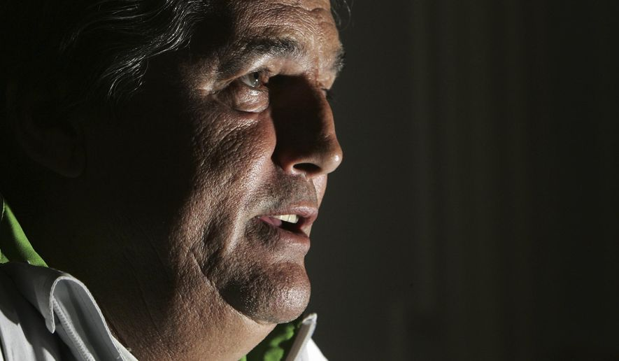 FILE - In this May 31, 2006 file photo, then Ivory Coast's national coach Frenchman Henri Michel attends a press conference in Vittel, eastern France. Henri Michel, who played for and coached France at the World Cup, died Tuesday April 24, 2018. He was 70. (AP Photo/ Christian Hartmann, File)