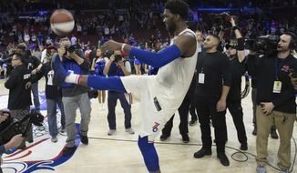 Philadelphia 76ers' Joel Embiid, of Cameroon, kicks the ball into the stands after the second half in Game 5 of a first-round NBA basketball playoff series against the Miami Heat, Tuesday, April 24, 2018, in Philadelphia. The 76ers won 104-91. (AP Photo/Chris Szagola)