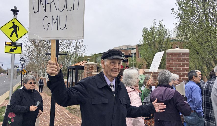 Students and faculty from George Mason University rally outside the Fairfax County courthouse in Fairfax, Va., Tuesday, April 24, 2018. A trial is underway on student-led lawsuit seeking documents detailing tens of millions in donations from the conservative Koch family to George Mason University. (AP Photo/Matt Barakat)