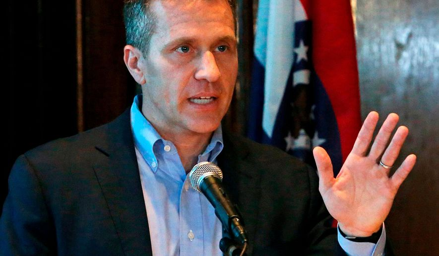 FILE - In this April 11, 2018 file photo, Missouri Gov. Eric Greitens speaks at a news conference in Jefferson City, Mo. A judge is expected to consider a request to disqualify St. Louis prosecutors from one of the two felony cases against Gov. Greitens. A hearing is scheduled for Tuesday, April 24, 2018 in the computer data tampering case against Greitens. Defense lawyers asked Judge Rex Burlison to require a special prosecutor in the computer tampering case, citing the use of a private investigator in the other felony case against Greitens. (J.B. Forbes/St. Louis Post-Dispatch via AP, File)