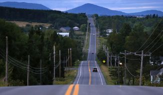 FILE - In this Aug. 6, 2017, file photo, motorists travel on Rte. 11 south of Patten, Maine, near the Katahdin Woods and Waters National Monument. Road signs directing motorists to the national monument are going to be installed now that Republican Gov. Paul LePage has relented in his opposition to the signs on Interstate 95 and state roads leading to the Mount Katahdin region. The Maine Department of Transportation will allow signs to be manufactured and installed now that Interior Secretary Ryan Zinke has recommended keeping the monument and a renewed request has been submitted by the superintendent for the federal land, the governor's office said. (AP Photo/Robert F. Bukaty, File)