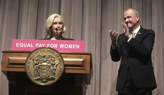 New Jersey Gov. Phil Murphy, right, applauds Lilly Ledbetter before signing into law a measure that strengthens New Jersey's law against discrimination and aims to quash pay disparities between men and women who do the same work, Tuesday, April 24, 2018, in Trenton, N.J. Ledbetter won a historic discrimination case against Goodyear Tire and Rubber Company. Congress passed a fair pay act in her name, the Lilly Ledbetter Fair Pay Act of 2009. (AP Photo/Mel Evans)