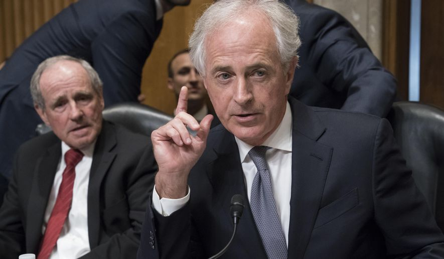 Sen. Jim Risch, R-Idaho, left, and Senate Foreign Relations Committee Chairman Bob Corker, R-Tenn., listen to comments during maneuvering on the confirmation vote for President Donald Trump's nominee for secretary of state, Mike Pompeo, who has faced considerable opposition before the panel, on Capitol Hill in Washington, Monday, April 23, 2018. (AP Photo/J. Scott Applewhite)