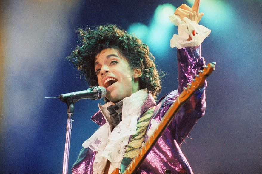 FILE - In this Feb. 18, 1985 file photo, Prince performs at the Forum in Inglewood, Calif. Prince's heirs have sued Walgreens and the Illinois hospital that treated the music superstar after he suffered from an opioid overdose, alleging that a doctor and various pharmacists failed to provide Prince with reasonable care, contributing to his death. (AP Photo/Liu Heung Shing, File)