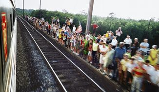 "In this 1968 photo provided by the San Francisco Museum of Modern Art is the photograph Paul Fusco, Untitled, from the series RFK Funeral Train, that is part of the exhibit, ""The Train: RFK's Last Journey,"" at the San Francisco Museum of Modern Art. (Paul Fusco/Magnum Photos, courtesy Danziger Gallery/San Francisco Museum of Modern Art via AP)"