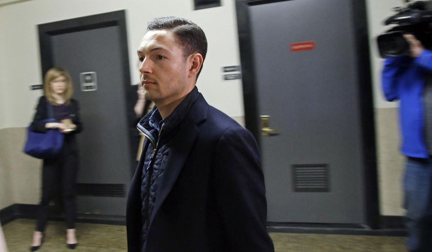 Bryon Hefner, the estranged husband of former Massachusetts Senate President Stan Rosenberg, walks into court for his arraignment at Suffolk Superior Court, Tuesday, April 24, 2018, in Boston. Hefner is making his first court appearance since being indicted on sexual assault and other charges. (AP Photo/Elise Amendola)
