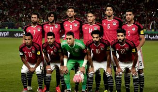 In this photo taken on Sunday, Oct. 8, 2017, Egypt's national soccer team pose for a photograph ahead of the 2018 World Cup group E qualifying soccer match between Egypt and Congo at the Borg El Arab Stadium in Alexandria, Egypt. (AP Photo/Nariman El-Mofty)