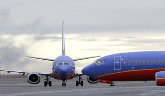 In this Jan. 26, 2016, file photo, a Southwest Airlines Boeing 737 waits to taxi to a gate to a gate at Seattle-Tacoma International Airport in Seattle. (AP Photo/Ted S. Warren, File)