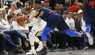 Utah Jazz guard Ricky Rubio, left, and Oklahoma City Thunder guard Russell Westbrook (0) battle for a loose ball in the second half during Game 4 of an NBA basketball first-round playoff series, Monday, April 23, 2018, in Salt Lake City. (AP Photo/Rick Bowmer)