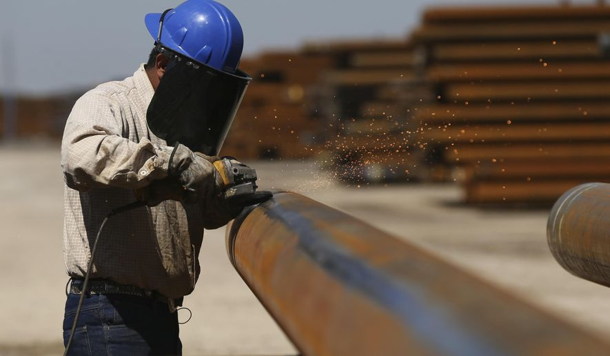 """Jose Mata grinds a steel pipe at the Borusan Mannesmann plant in Baytown, Texas, Monday, April 23, 2018. President Donald Trump's escalating dispute with China over trade and technology is threatening jobs and profits in working-class communities where his """"America First"""" agenda hit home. Without a waiver, Borusan Mannesmann Pipe may face tariffs of $25 million to $30 million annually if it imports steel tubing and casing from its parent company in Turkey, according to information the company provided to The Associated Press. (AP Photo/Loren Elliott)"""