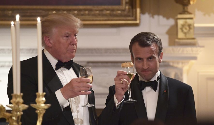 President Donald Trump, left, and French President Emmanuel Macron share a toast during the State Dinner at the White House in Washington, Tuesday, April 24, 2018. (AP Photo/Susan Walsh)