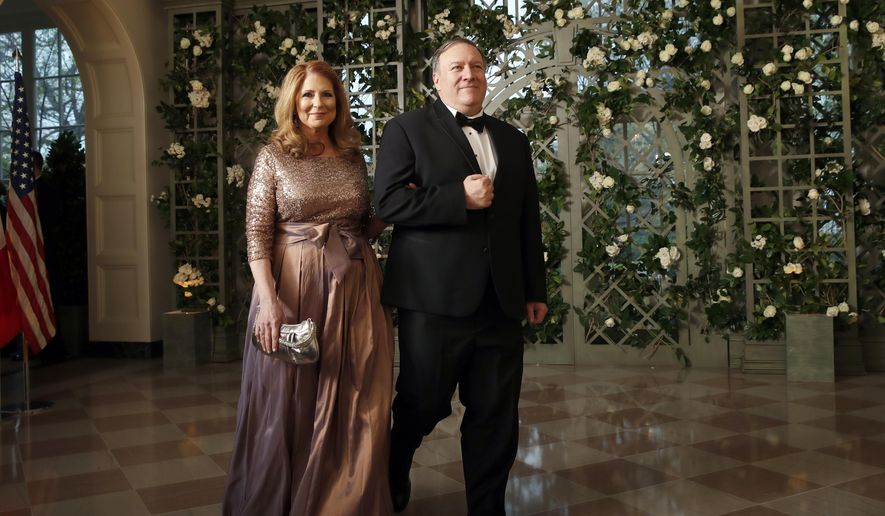 CIA director Mike Pompeo and his wife Susan Pompeo arrive for a State Dinner with French President Emmanuel Macron and President Donald Trump at the White House, Tuesday, April 24, 2018, in Washington. (AP Photo/Alex Brandon)