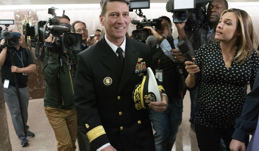 Rear Adm. Ronny Jackson, President Donald Trump's choice to be secretary of the Department of Veterans Affairs, leaves a Senate office building after meeting individually with some members of the committee that would vet him for the post, on Capitol Hill in Washington, Tuesday, April 24, 2018.  (AP Photo/J. Scott Applewhite)